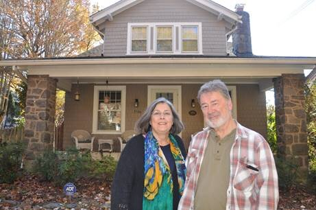 Pam and Carl Lankowski in front of their 1919 kit house no McKinley Street NW