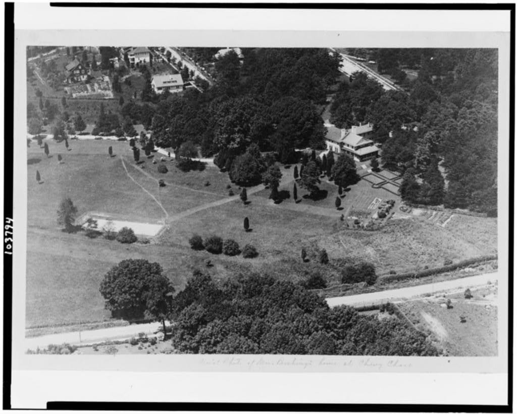 Aerial photo showing the front of Highwood, as taken from the southeast. Undated, but it is likely between 1919 and 1921 as evidenced by existing houses and still-empty lots west of Highwood. The driveway leading off to the left side of the photograph is in the direction of where the gate post is today. Photo from the Library of Congress.
